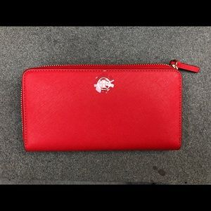Tory Burch red leather wallet.